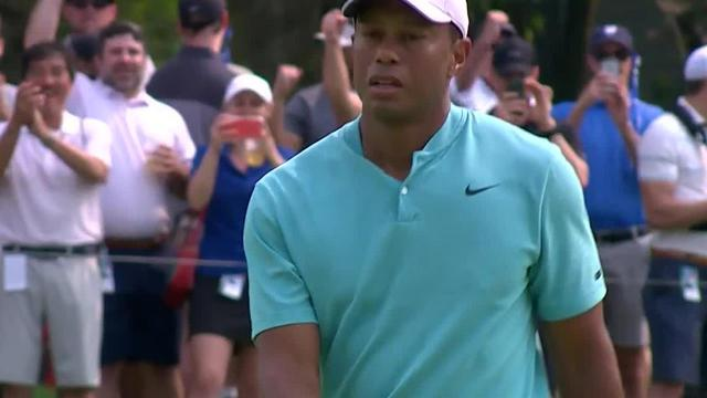 Tiger Woods rolls in 23-footer for birdie at the Memorial