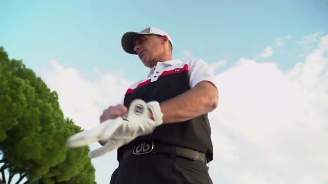 Premier League referee Mike Dean shows off his golf skills