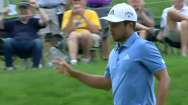 Xander Schauffele rolls in lengthy birdie putt at the turn at the Memorial