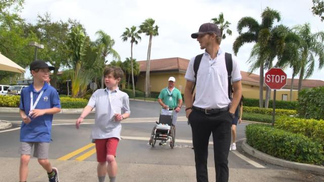 Morgan Hoffmann meets young fan with muscular dystrophy at Honda