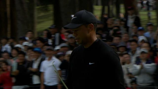Tiger Woods fist bumps after birdie putt at ZOZO