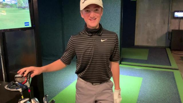 Shriners Hospitals National Patient Ambassador gets surprise at golf simulator