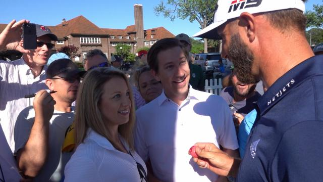 Dustin Johnson helps with gender reveal at Rocket Mortgage