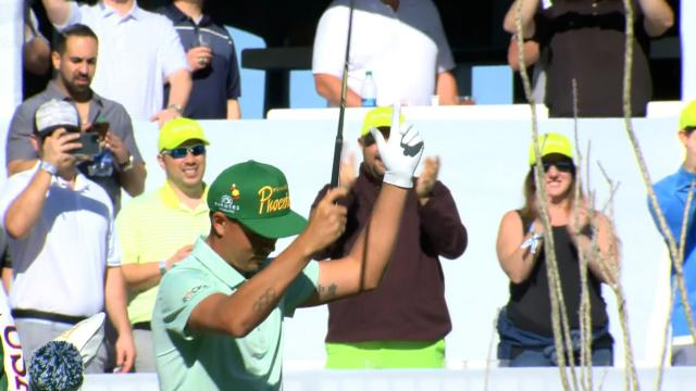 Rickie Fowler plays to the crowd before birdying No. 16 at Waste Management