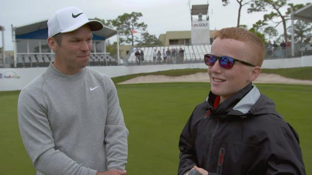 Paul Casey surprises a young fan at Valspar