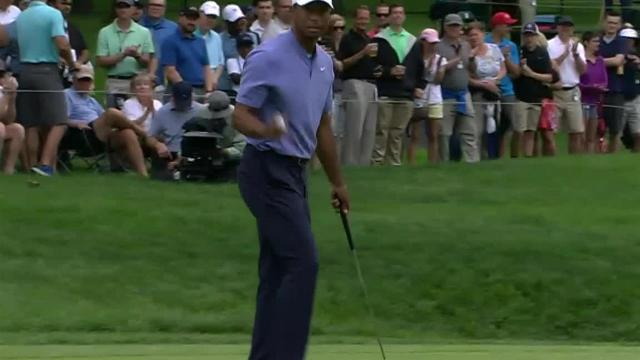 Tiger Woods scrambles for birdie at the Memorial
