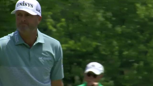 Ryan Palmer wraps approach around a tree to set up birdie at John Deere