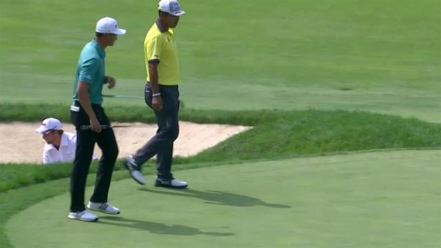 Hideki Matsuyama chips in from the deep rough for birdie at the Memorial