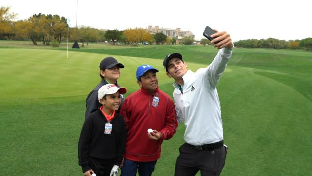 Joaquin Niemann practices with members of The First Tee at Valero
